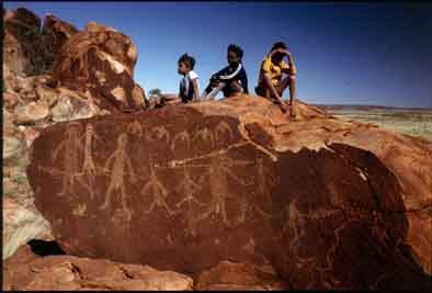 Aborigines at Pilbara petroglyph site