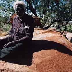 Senior traditional custodian Monty Hale with the oldest currently dated rock art of Australia, c. 30 000 years old.